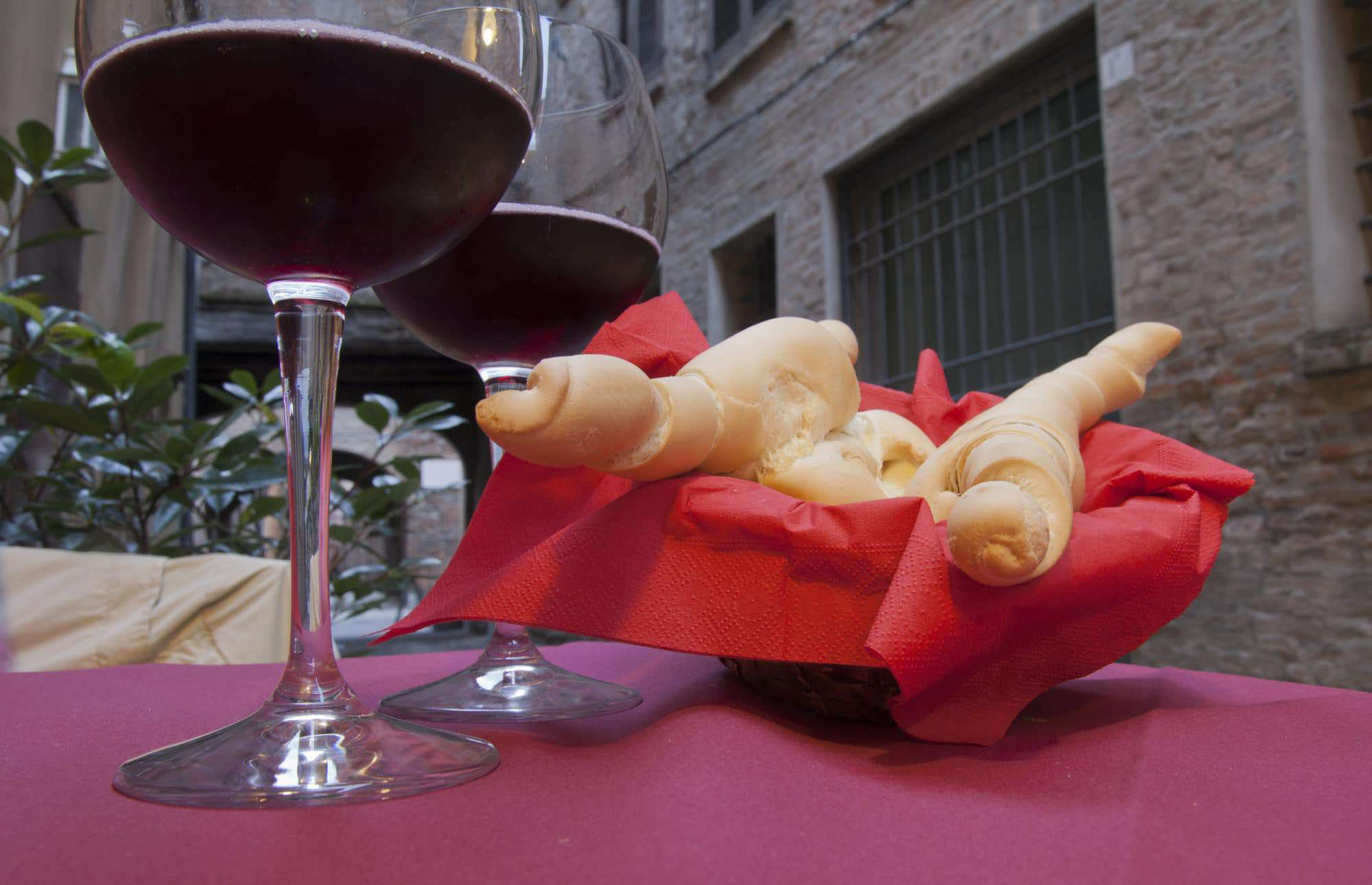 bread and red wine in Ferrara city, Italy