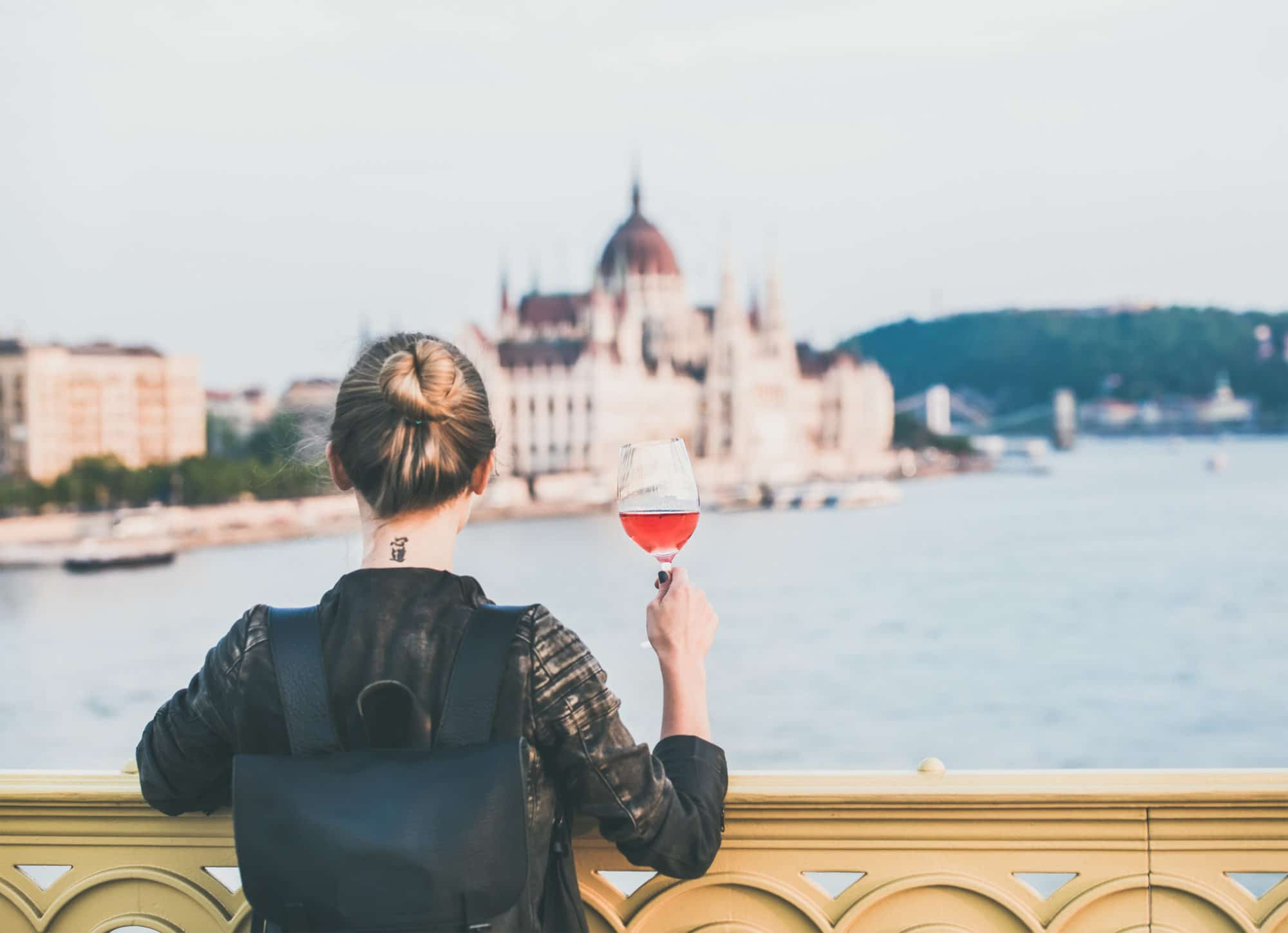 Wine Travel Bag Young woman standing with glass of rose wine in Budapest